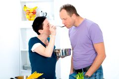 Man test the good food of his wife Royalty Free Stock Images