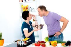 Man test the good food of his wife Royalty Free Stock Photography