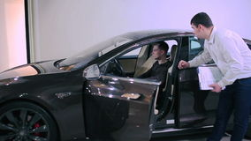 Man test the sunroof in electric car
