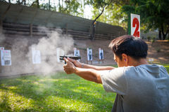 A man testing fire for Glock 19 Gen 4 Stock Images