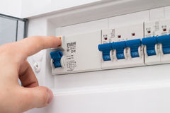 Man testing the fuse box Royalty Free Stock Image
