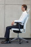 Man testing office chair royalty free stock image