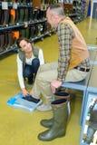 Man testing pair boots Royalty Free Stock Photo