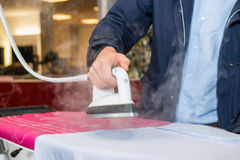 Man Testing Steam Iron Before Buying From Hypermarket Royalty Free Stock Image
