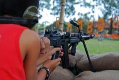 Free Man Testing The Machine Gun Stock Photography - 3107052