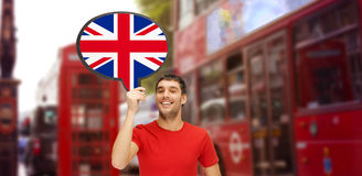 Man with text bubble of british flag in london Stock Image