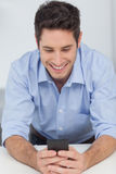 Man text messaging with his smartphone Royalty Free Stock Photos