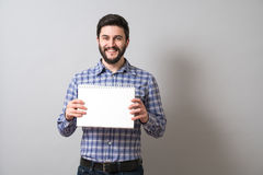 Man with textbook. Handsome bearded man holds textbook. Education or business concept Stock Photography