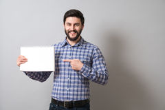 Man with textbook. Handsome bearded man holds textbook. Education or business concept Royalty Free Stock Image