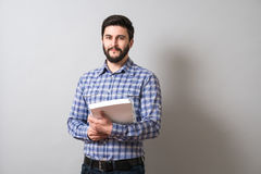 Man with textbook. Handsome bearded man holds textbook. Education or business concept Stock Photo