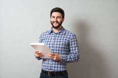 Man with textbook. Handsome bearded man holds textbook. Education or business concept Stock Image
