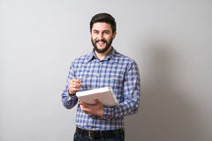 Man with textbook Stock Images