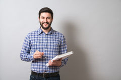 Man with textbook. Handsome bearded man holds textbook and pen. Education or business concept Royalty Free Stock Photo