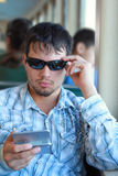 Man Texting. Guy with sunglasses sends a text message while commuting Royalty Free Stock Images