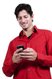 Man Texting. Handsome man using a cell phone for texting Royalty Free Stock Images