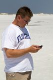 Man Texting At Beach Royalty Free Stock Photo
