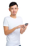 Man texting on cell phone Royalty Free Stock Photography