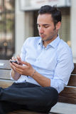 Man texting with cell phone Stock Image