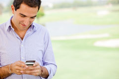 Man texting on his phone Royalty Free Stock Images