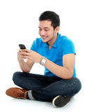 Man texting message. Young asian man texting message at his mobile phone Stock Photos