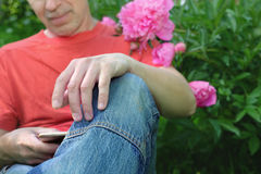 Man Texting On Mobile Phone Stock Photo