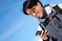 Man texting outdoors Stock Photo