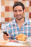 Man texting over breakfast Stock Images