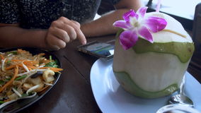 Man Texting on Phone in Asian Restaurant stock video footage