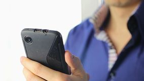 Man texting from touch phone using one hand, focus, close-up. Stock footage stock video