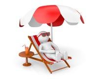 man on th ebeach under sun umbrella Stock Photos