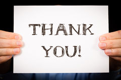 Man with Thank You sign. Studio shot of man holding white sign with the words Thank You Royalty Free Stock Photography