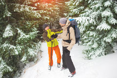 The man thanked the friend for the help. Winter backpack trip, the men thanked the friend for their assistance, men greet each other on the background of snow stock photography