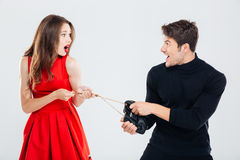 Man theif stealing young woman bag Stock Images