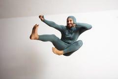Man in thermal baselayer wear ninja suit set stock photo