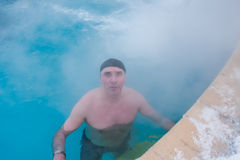 A man in a thermal pool Stock Photography