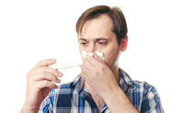 The man with the thermometer wipes snivels a scarf Stock Images