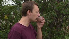 Man with thermos drinking tea outdoors stock video