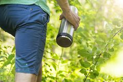 The man with the thermos. Picnic, Hiking, summer, autumn. The concept of a walk in the woods Royalty Free Stock Photo
