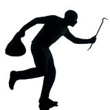 Man thief criminal running silhouette Stock Image