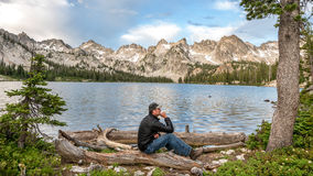 Man in the think position at a mountain lake Royalty Free Stock Photo
