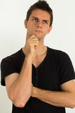 Man thinking. With hand on face Stock Photo