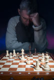 Man thinking behind chessboard. Stock Photography