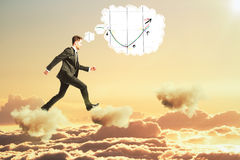Man thinking about business graph and walking on clouds concept Royalty Free Stock Photos