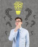 Man thinking. Businessman thinking and drawing lamp over head Royalty Free Stock Photos