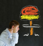 Man thinking chalk nuclear bomb cloud blackboard background Royalty Free Stock Photography