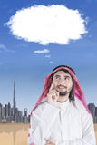 Man thinking with cloud speech Royalty Free Stock Photo