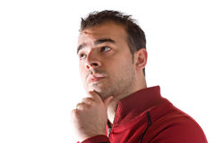 Man Thinking Deeply. A young man thinking about something deeply with his hand on his chin Stock Photography