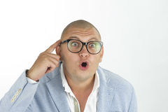 Man thinking while doing a silly face with nerd glasses Royalty Free Stock Images