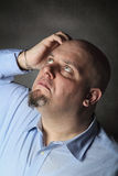 Man with thinking expression and pose Stock Photo