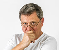 Man in thinking gesture Stock Images